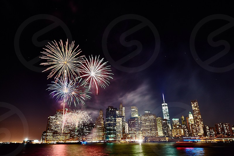 fireworks display over city buildings photo