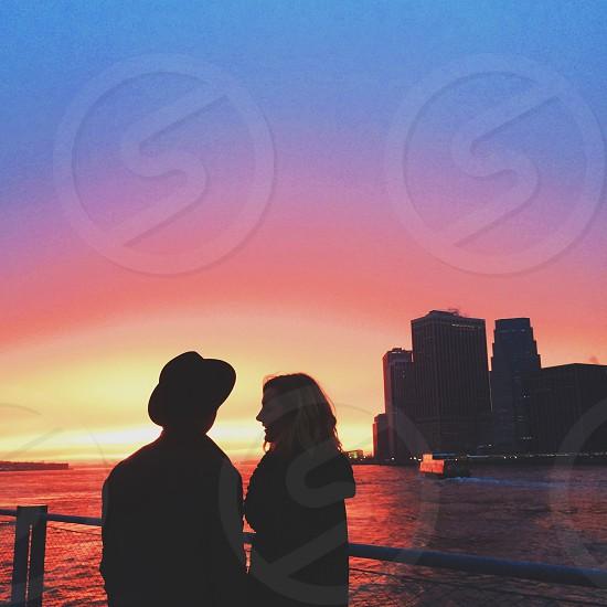 couple watching sunset photo