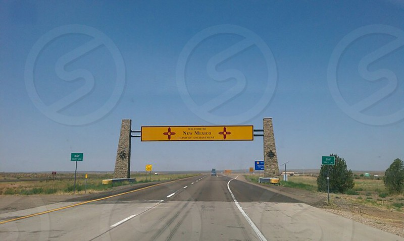 Welcome to New Mexico sign landmark on highway interstate as entering state photo
