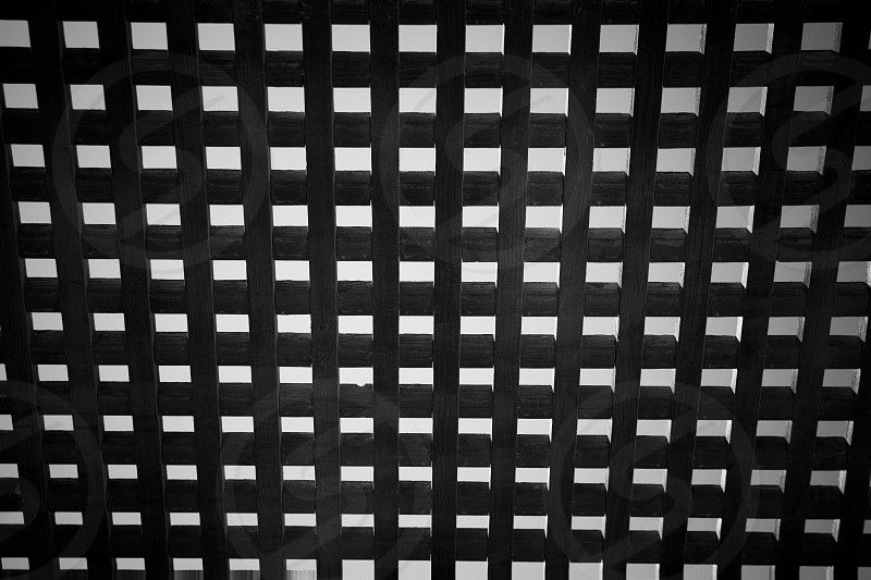 Wooden square grid - abstract black and white. photo