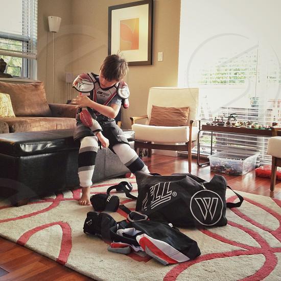 boy putting padded armor photo
