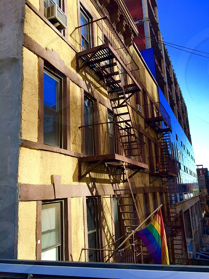 Connected by the fire escape Rainbow Flag New York City photo