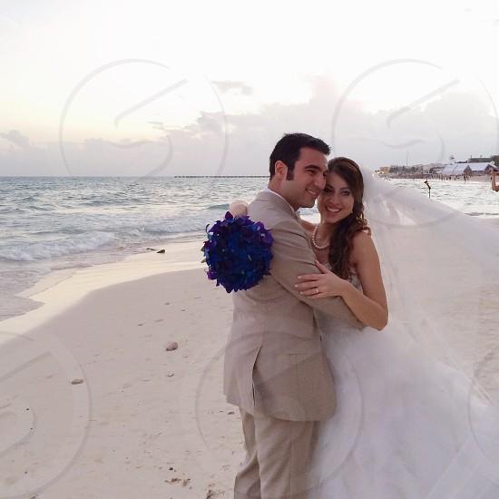 newlywed couple hugging photo