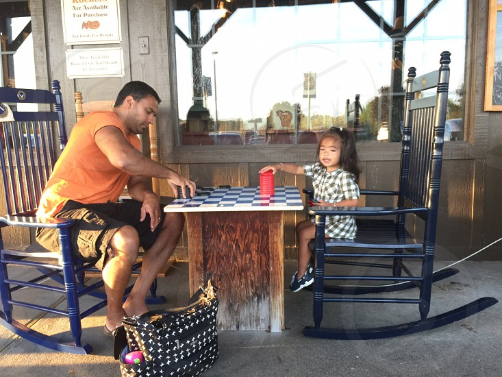 man and a girl playing game board photo