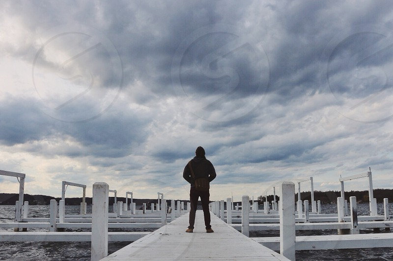 person standing on dock photo