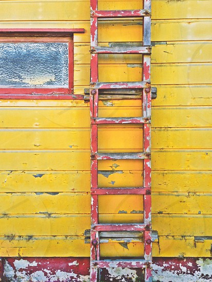 Old ladder yellow wall photo