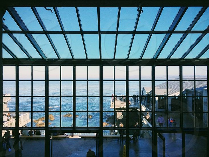 glass windows and ceiling with panels photo