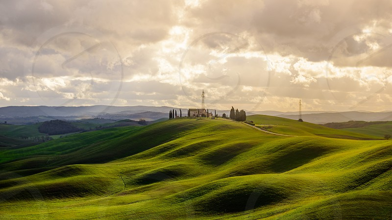 Tuscany Italy countryside siena hills sunset house quiet peaceful travel travel destination scenic view landscape nature green sunset clouds trees agriculture field relax photo