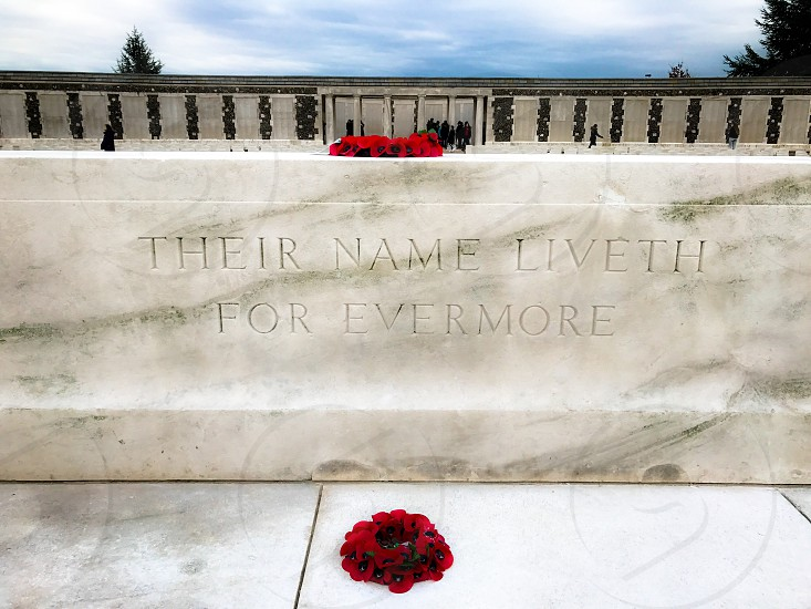 Outdoor day landscape horizontal colour Tyne Cot Cemetery Allied British Commonwealth graveyard graves gravestones memorial War remembrance white marble stone carved grass fields poppies countryside Ypres salient Europe European fields sky nature rest peace beauty silence wreath respect photo