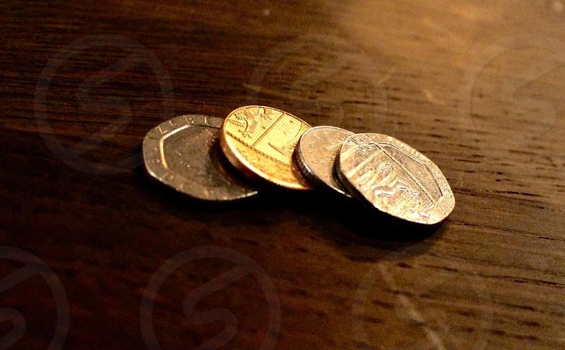 Pound coins on a table warm lighted photo