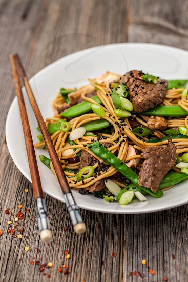 Ramen noodles with beef and sugarsnaps photo