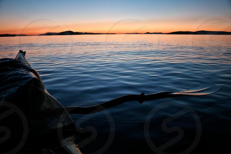 Kayaking at sunset in the San Juan Islands Washington.  photo