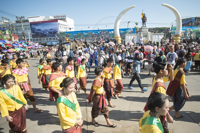 Elephants and People at the Elephant Square in the city centre of Surin at the Elephant Round-up Festival in the city of Surin in Northeastern Thailand in Southeastasia.  photo