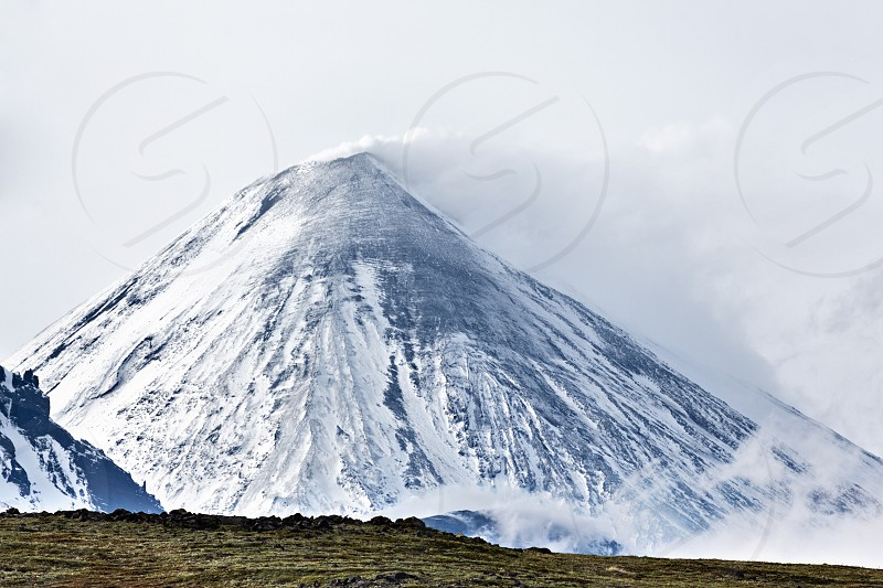 Beautiful nature of Kamchatka - mountain landscape: view on Klyuchevskoy Volcano (Klyuchevskaya Sopka) - highest mountain on Kamchatka the highest active volcano of Eurasia. photo