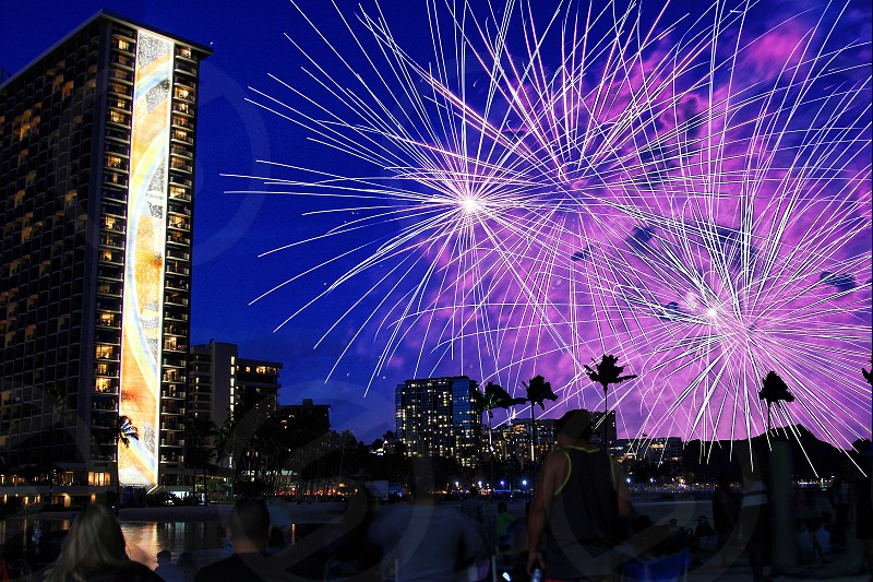 Celebrating the 4th of July with fireworks on Waikiki Beach in Honolulu Hawaii photo