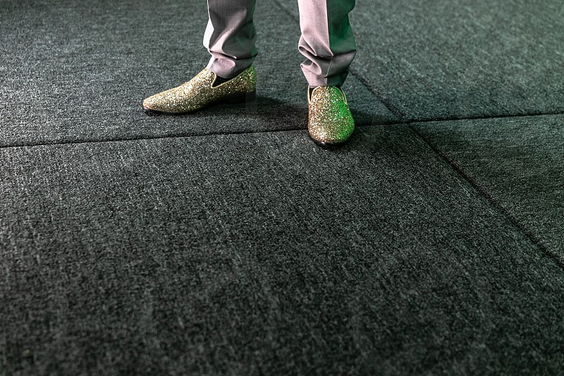 Fancy shoes on grey flooring.  photo