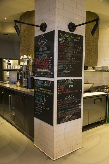 chalkboard signage on white brick post photo