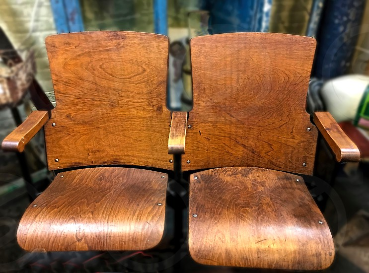 Old fashioned wooden brown theater seats that fold up photo