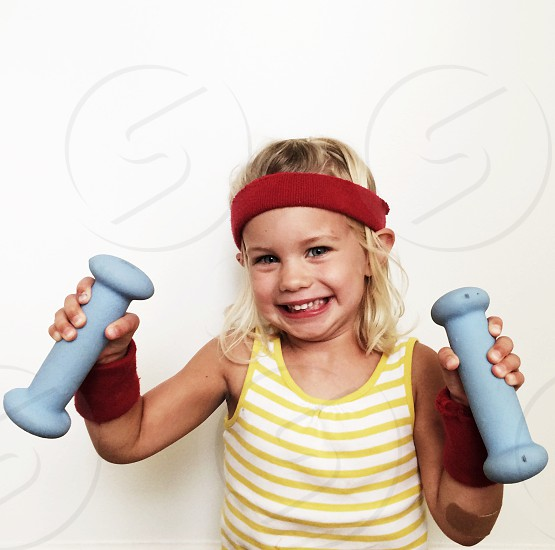 Girl kid fitness funny weights exercise photo
