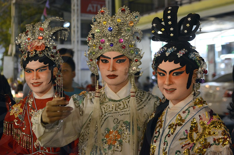 artists of a chinese opera at a nightmarket at the Santichaiprakan Park at the Mae Nam Chao Phraya River in the city of Bangkok in Thailand in Southeastasia. photo