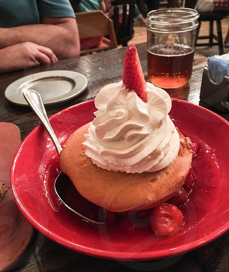 Strawberry shortcake - it's what's on the table!  Strawberry shortcake dessert whip cream delicious eat table share sweet treat  photo