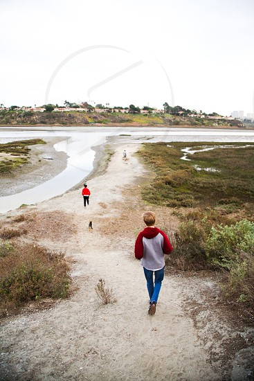 two person walking beside the river  photo