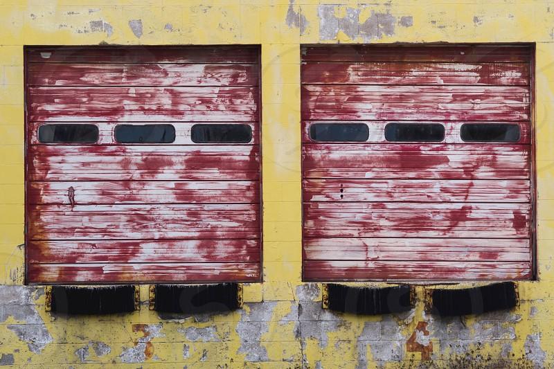Abandoned garage doors at a warehouse loading dock. photo