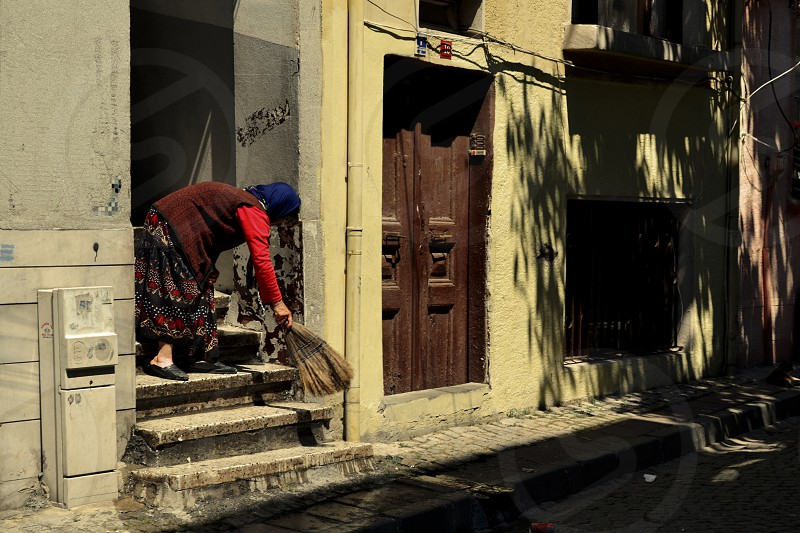 Woman cleaning steps at front door Istanbul photo