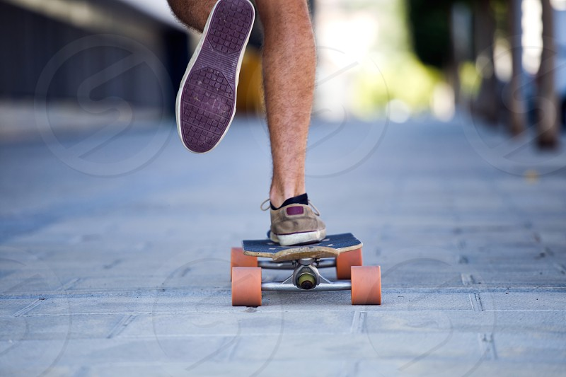 detail of a skateboarder legs in the street photo