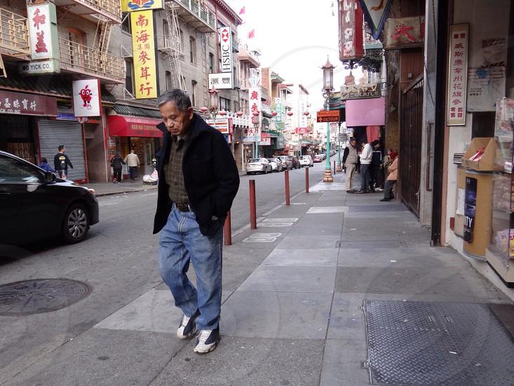 man walking beside road way  photo