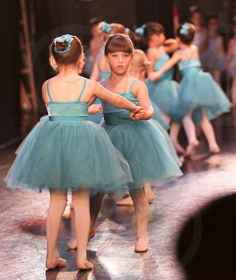 Ballet recital girls dancing on stage. photo
