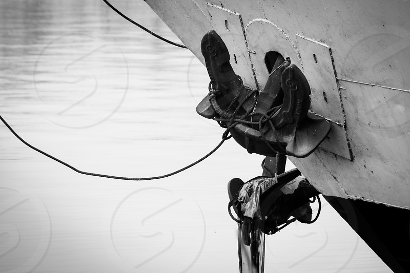 boat floating ship river sea nile island tied rope close_up heavy black&white black and white calm stand stop sidewalk boarding board on_board travel transportation photo
