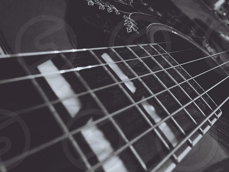 black acoustic guitar photo