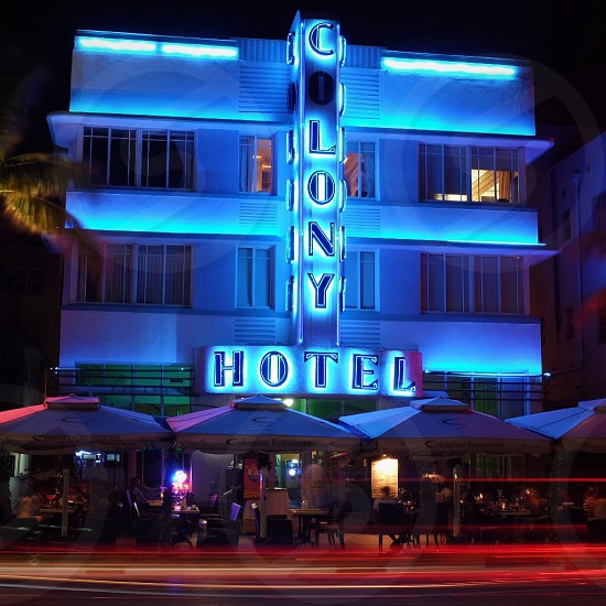 lighted Colony Hotel during nighttime photogrpahy photo