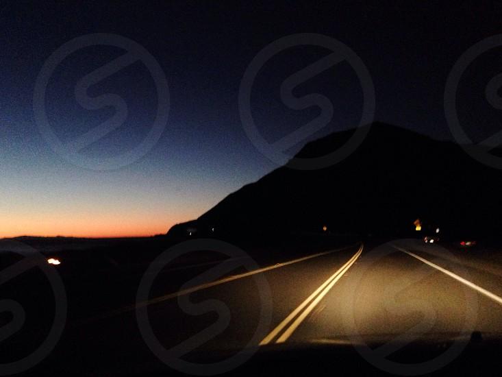 night roadway and mountain photograph photo