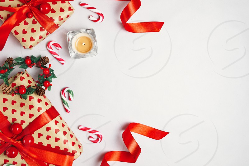 Christmas composition. Gifts red decorations on white background. Christmas winter new year concept. Flat lay top view with copy space photo