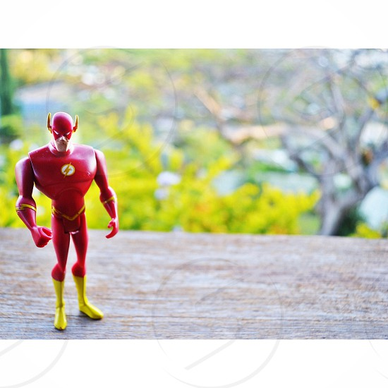 shallow focus photography of The Flash action figure during daytime photo