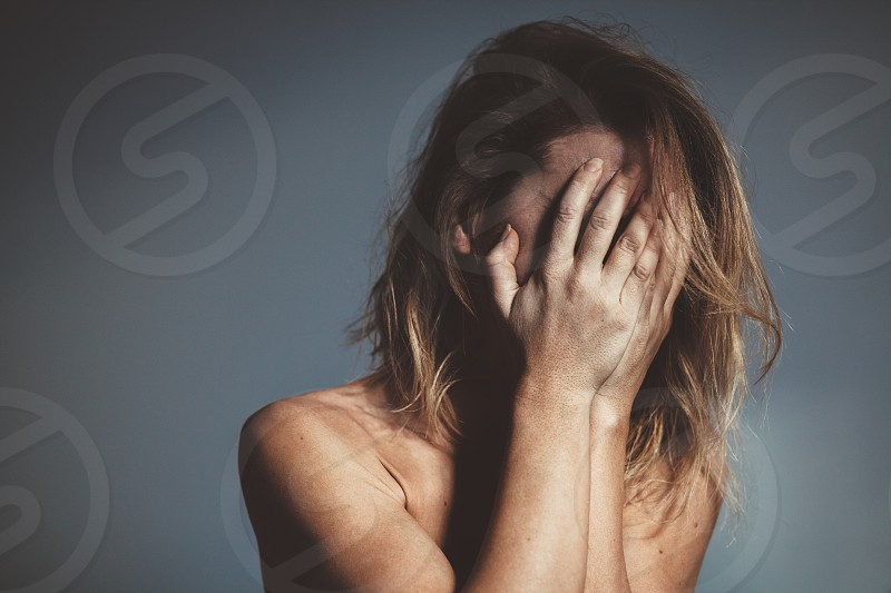 Young woman sad and crying photo