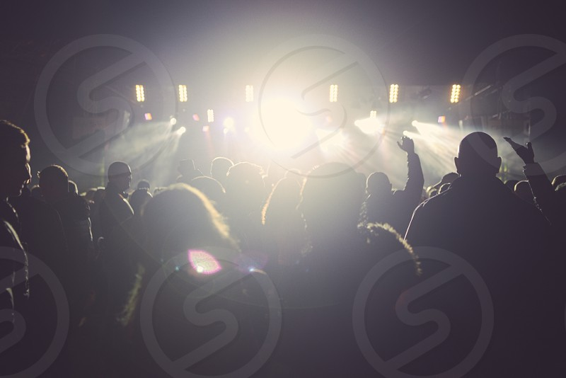 Backlit People at Concert and Strong Spotlights photo