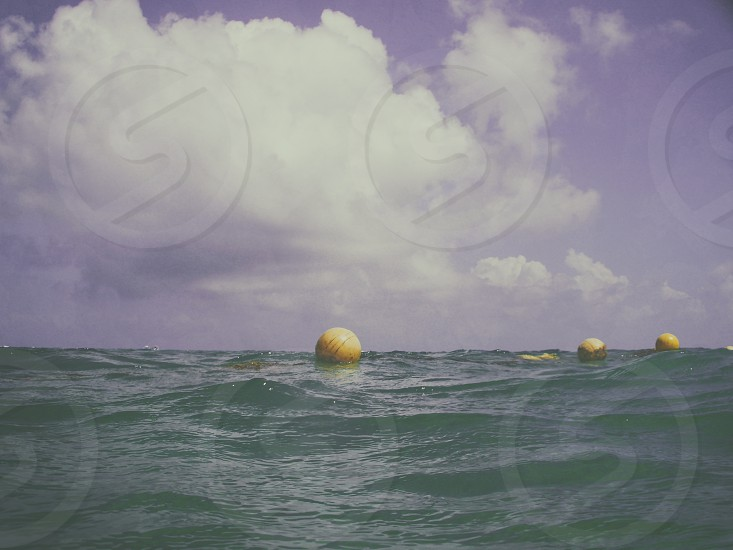 yellow round buoys photo