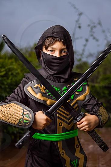 Boy dressed up as Ninja for Halloween photo
