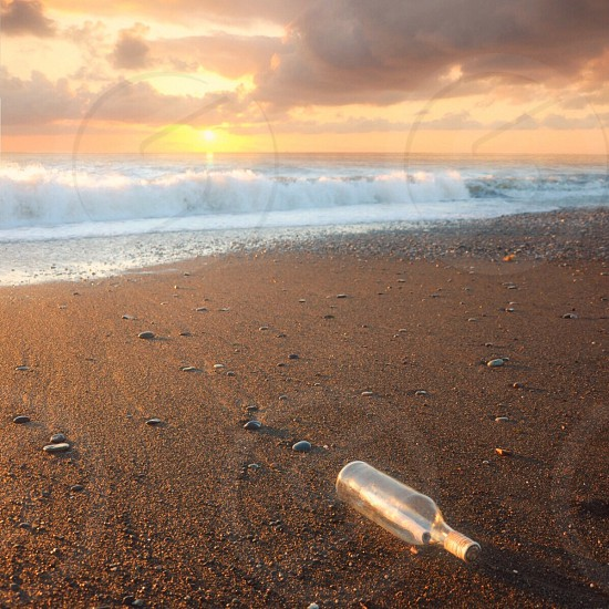 clear glass bottle and seashore photo