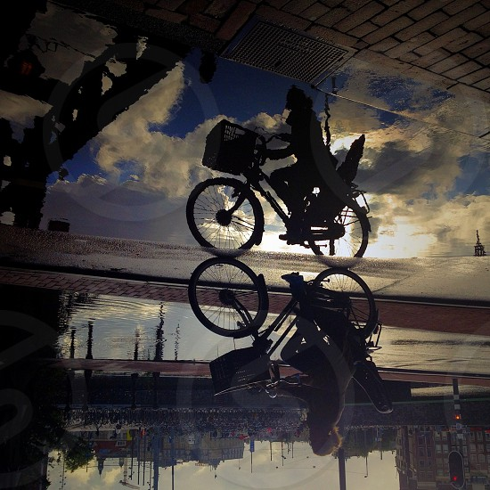 man riding bicycle silhouette photo