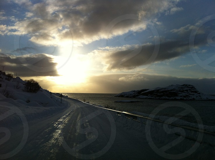 road covering snow during sunset photo