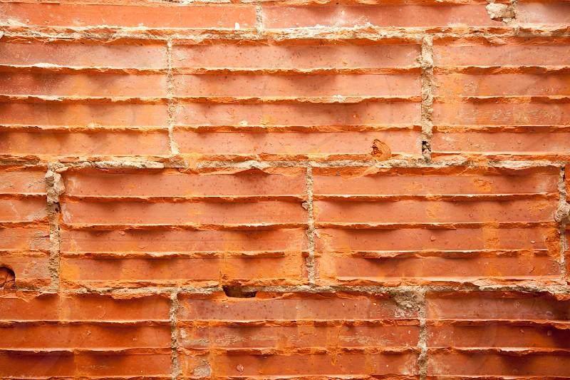 broken bricks in brickwall in wall restoration construction photo