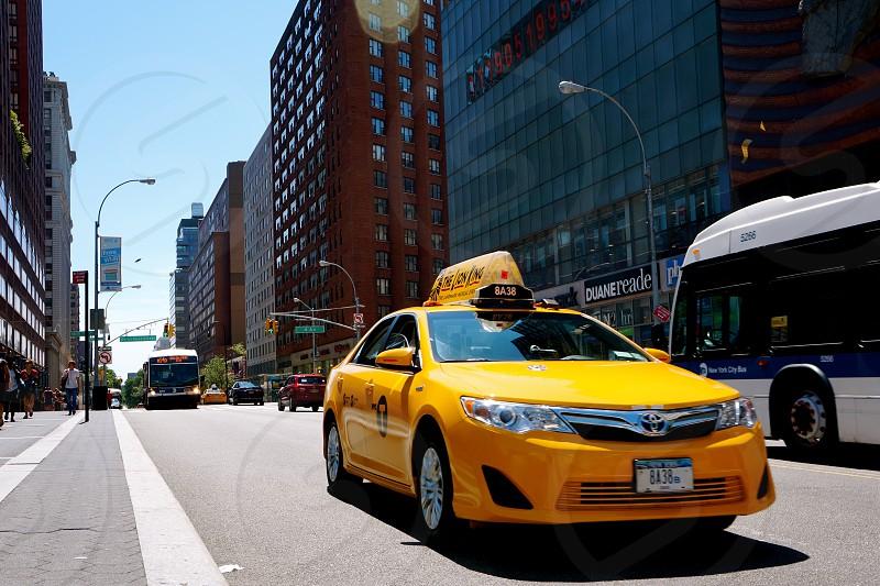 yellow cab approaching photo