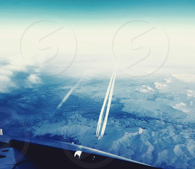 aerial photography of jet plane flying near white clouds photo