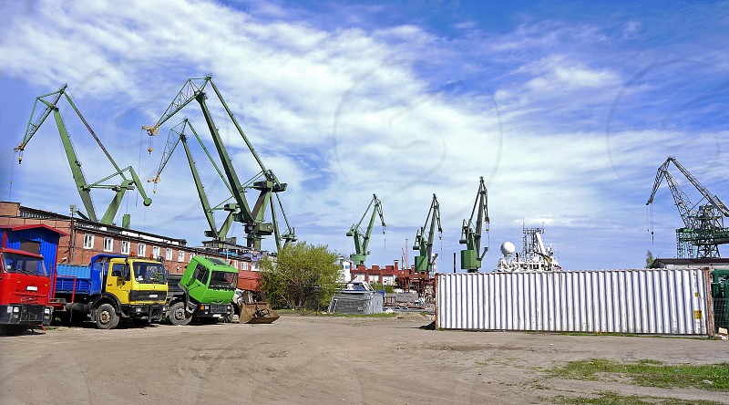 Crane gdansk. Shipping cranes in Gdansk. Industrial site in Poland. Cargo cranes during the day photo