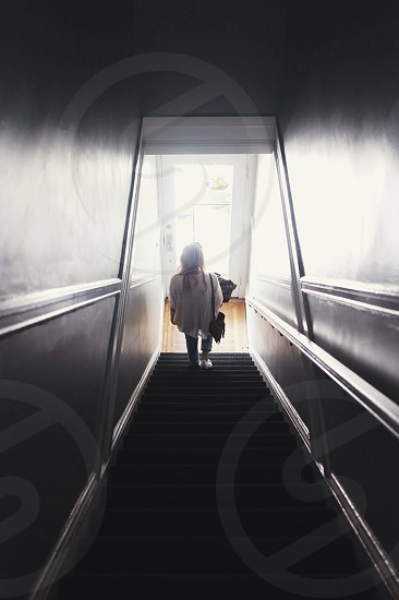 person walking down the staircase photo