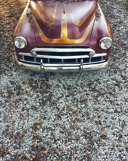 dark red and gold classic car photo